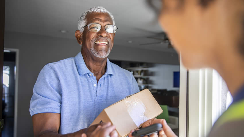 Man receiving CPAP Machine he bought using CPAP Financing